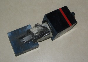 "This picture clearly shows how the bottom inch of the ""Extra Charcoal"" appliance is molded into the case. The plastic tape, which is layered on top of the white tape, is also clearly visible.  The Extra Charcoal appliance does actually have charcoal, but it does not fully surround the Carbon/Steel/Glass core."